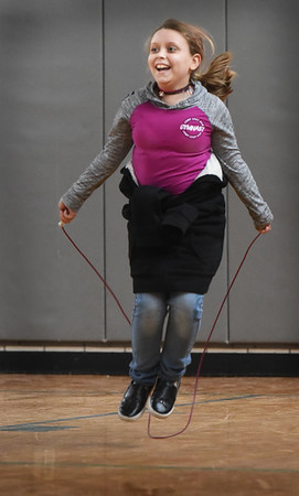 BRYAN EATON/Staff Photo. Jesannia Daneau, 9, practices different jump rope moves as she and her classmates watch an instructional video in Linda Gangemi's physical education class at Salisbury Elementary School. At the end of the six week program the students will have created their own choreographed routine.