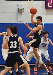 BRYAN EATON/Staff photo. The Generals' Ian Coffey goes for a rebound.