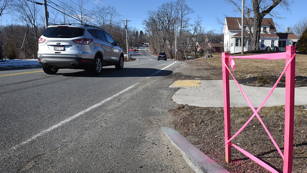 BRYAN EATON/Staff Photo. Pink tape on utility poles and pink stakes can be seen all along Elm Street in Amesbury ahead of upcoming road reconstruction.
