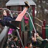 BRYAN EATON/Staff Photo. Wednesday wasn't the warmest day of the week, but it was nice enough for youngsters at the Boys and Girls Club in Salisbury. Chloe Borrelli, 9, of Amesbury and her friends have fun on the swings while others played flag football.