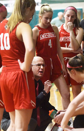 BRYAN EATON/Staff photo. Amesbury head coach Gregg Dollas with his team during a timeout.
