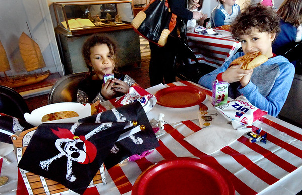 BRYAN EATON/Staff Photo. Lyla Ericson, 4, and brother MIkah, 6, of Newburyport enjoy the Pirate Pizza Party after a scavenger hunt during Pirate Day at the Custom House Maritime Museum on Wednesday. The event was one of several the museum held for its Family Fun Days for school vacation.