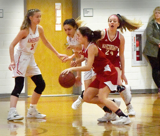 BRYAN EATON/Staff photo. Masconomet's Paige RIchardson drives past Amesbury defenders as she attempt two points.