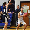 BRYAN EATON/Staff photo. Jack Lucido looks to shoot as Hamilton-Wenham's Carter Coffey puts on the pressure.