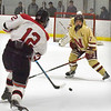 BRYAN EATON/Staff photo. Newburyport defenseman Ryan Philbin gets between Winchester's Colin Van Stry and goalie Jaime Brooks.