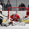 BRYAN EATON/Staff photo. Amesbury goalie Tre Marcotte stops a shot by Haverhill.