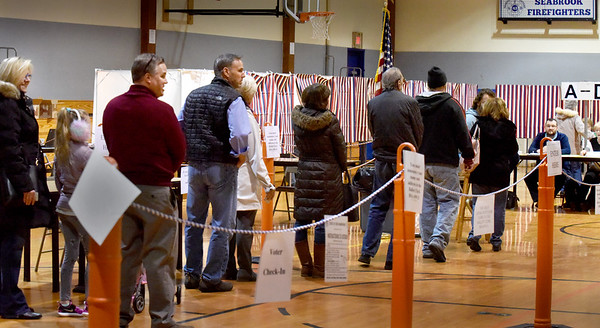 BRYAN EATON/Staff Photo. Voters at the Rec Center in Seabrook wait to cast their ballots in the presidential election on Tuesday morning. By noon, nearly 800 residents had cast their ballots.