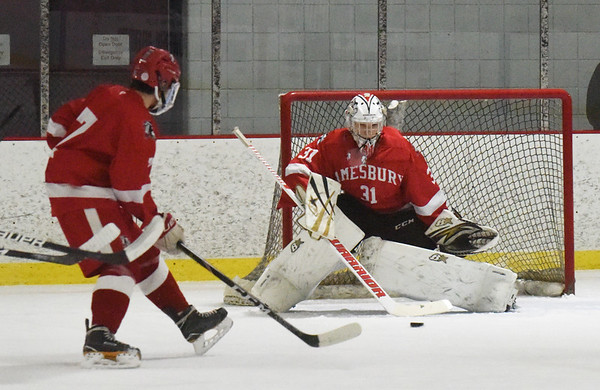 BRYAN EATON/Staff photo. Amesbury goalie Tre Marcotte stops the puck in action with Newburyport.