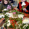 BRYAN EATON/Staff Photo. Gayle Smith, left, and Joan Larnard, both of Newburyport, seperate flowers, greenery and baby's breath at the Newburyport Senior and Community Center. They were is a class creating mini-centerpieces for Valentine's Day taught by Pan Cannon, owner of Beach Plum Flower Shop.