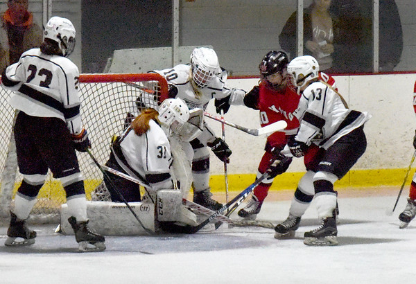 BRYAN EATON/Staff photo. Hingham gets the puck past Jenny Hubbard for the first goal of the game.