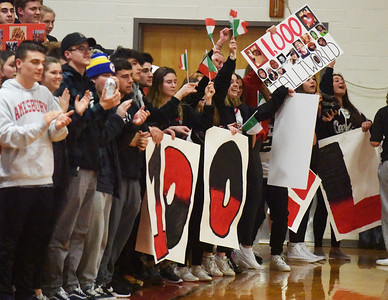 BRYAN EATON/Staff photo. Amesbury High School students who were keeping a countdown to Napoli's milestone applaud its fruition.