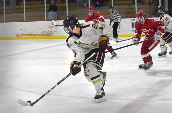 BRYAN EATON/Staff photo. Newburyport's Zachary Wilson moves the puck back into Amesbury ice.