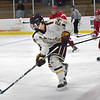 BRYAN EATON/Staff photo. Newburyport's Zachary Wilson moves the puck back into Amesbury ice.
