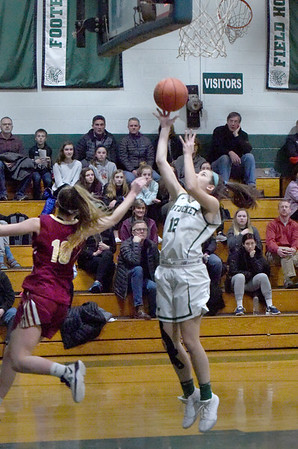 BRYAN EATON/Staff photo. Pentucket's Alyssa Thompson gets two on this layup as Samantha Cavanaugh was too far down court to try to block.