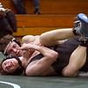 BRYAN EATON/Staff photo. Triton's Dylan Karpenko, back, works on pinning Pentucket's Adam Newman in the 132 pound class.