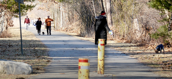 BRYAN EATON/Staff Photo. Dozens of people were on the Great Eastern Marsh Trail in Salisbury on Monday afternoon as the warmer weather continued from the weekend. It does cool down some mid-week with some rain as well and temperatures back in the 30's over the weekend.
