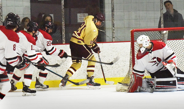 BRYAN EATON/Staff photo. Clipper forward Anthony Lucci gets close to the goalie with Winchester players close behind.