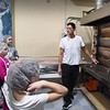 BRYAN EATON/Staff Photo. Bill Malatesta shows off the huge oven that bakes all their products.