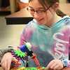BRYAN EATON/Staff Photo. Adele Bailin, 10, turns the cogs to wiggle around wormy characters she created with the construction kit Wacky Robots. She was at the Amesbury Youth Recreation's Afterschool Program at Amesbury Elementary School.