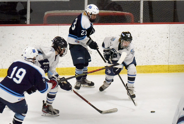 BRYAN EATON/Staff photo. Triton's Benjamin Rennick tries to get into position for a shot on net.