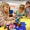 BRYAN EATON/Staff Photo. Working on their Lego homes at Salisbury Elementary School are, from left, Josephine Bizari, Rachael Davis and Natalie Pesce, all 8. The six week unit is part of the afterschool Explorations program, this one run by school psycologist Angela Curtis.