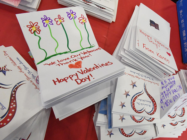 BRYAN EATON/Staff Photo. Valentine cards made by area students were sent to the event for packaging.