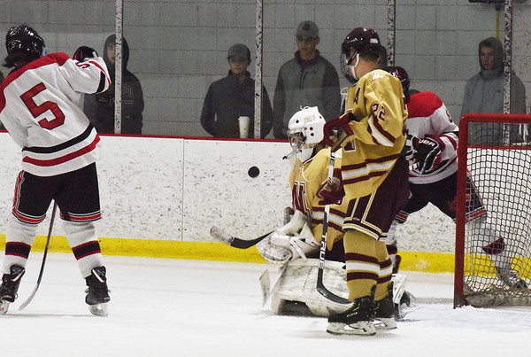 BRYAN EATON/Staff photo. Goalie Jaime Brooks is ready for the shot on net as Owen Spence covers.