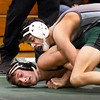 BRYAN EATON/Staff photo. Triton's Chris Montes tries to turn Jackson Newmann in the 120 pound class.