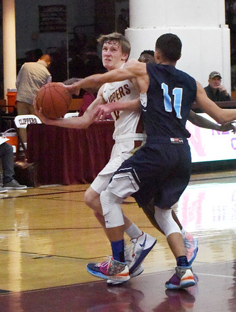 BRYAN EATON/Staff photo. Fehlner IV, John is fouled by Dracut in the second quarter.