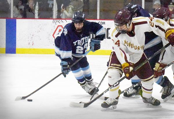 BRYAN EATON/Staff photo. Newburyport's Zachary Wilson moves in on James Tatro.