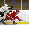 BRYAN EATON/Staff photo. Amesbury's Ian Pelletier moves the puck with Brady Ferreira on his back.