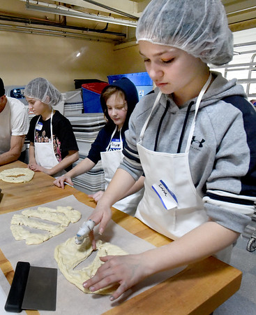 BRYAN EATON/Staff Photo. Lana Whitty, 11, creates shapes in her fougasse, which is decorative-like foccacia.