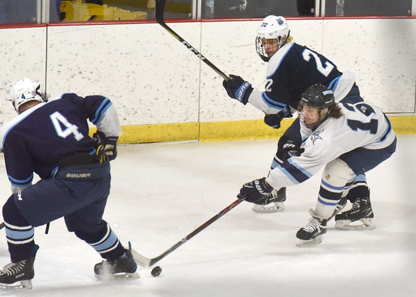 BRYAN EATON/Staff photo. The puck gets away from Michael Beevers while trying to shoot on net.
