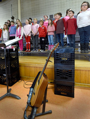 """BRYAN EATON/Staff Photo. The fourth grade Cashman School Chorus perform's """"You've Got a Friend"""" during an all school assembly on Wednesday. A second show, also conducted by music teacher Grace Sweet, was held for parents at night."""