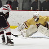 BRYAN EATON/Staff photo. Newburyport goalie Jamie Brooks spreads wide but Winchester's Colin Van Stry gets the point.