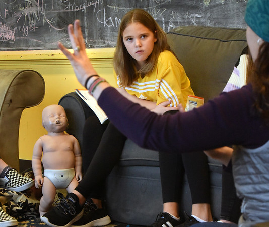 BRYAN EATON/Staff Photo. Morgan Sweet, 12, listens intently as Margot Harrington talks about the basics of CPR in the Safe Sitter class at Newburyport Youth Services' Rec Center.