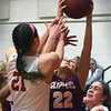 BRYAN EATON/Staff photo. Alli Napoli and Newburyport's Sadie Vanderberg go for a rebound.