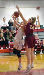BRYAN EATON/Staff photo. Abigail Gillingham tries to block a shot by Amesbury's Avery Hallinan.