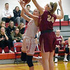 BRYAN EATON/Staff photo. Abigail Gillingham tries to block a shot by Amesbury's Avery Hallinan.