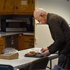 BRYAN EATON/Staff photo. Duncan MacBurnie cuts up some pie to put out near the coffee.