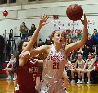 BRYAN EATON/Staff photo. Paige Richardson and Alli Napoli try for the rebound.