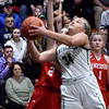 BRYAN EATON/Staff photo. Pentucket's MacKenzie Currie muscles past Amesbury's Clara Sullivan.