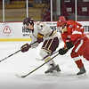 BRYAN EATON/Staff photo. Zachary Wilson pulls away from Amesbury forward Derek Pappalardo.