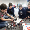 BRYAN EATON/Staff Photo. Two Triton High seniors are using the skills they learned in a robotics class to teach youngsters at the afterschool Explorations Program at Salisbury Elementary School. The two, George Phaneuf, left, and Jake Phillips work with Aengus Longtin, 8, and Cameron Neary, 10, right.