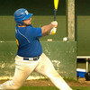 BRYAN EATON/ Staff Photo. Rams' Marc Luisi hits a single at Eiras Park.