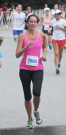 JIM VAIKNORAS/Staff photo Patty St John of Amesbury finishes the Lions Club Yankee Homecoming 5k in Newburyport.