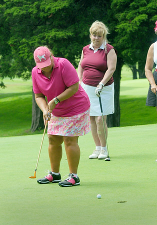 BRYAN EATON/ Staff Photo. Jo Buffum of Bradford putts on the ninth hole as teammate Gayle McKinley of Newburyport looks on.