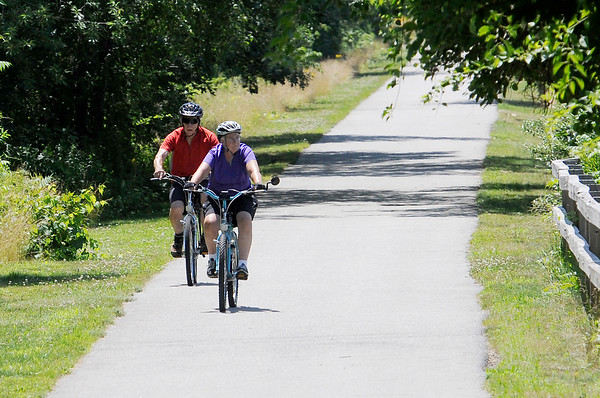 TIM JEAN/Staff photo<br /> <br /> Cyclists make their way along the Old Eastern Marsh Rail Trail in Salisbury. Work on connecting the Clipper City Trail in Newburport and the Ghost trail in Salisbury will soon begin. 7/9/18