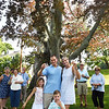 BRYAN EATON/Staff photo. Drew and Sarah Sansone, with children Logan, 6, and Leighton, 2, with neighbors toast two copper beech trees at their 51 High Street home which are being taken down Friday. The trees, more than 200 years old, have lost limbs over the years and are rotted and diseased.