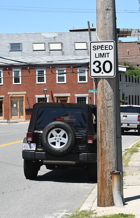 JIM VAIKNORAS/Staff photo Speed limit signs on opposite sides of Water Street in Newburyport one heading east says 25v MPH and one heading west says 30 MPH.